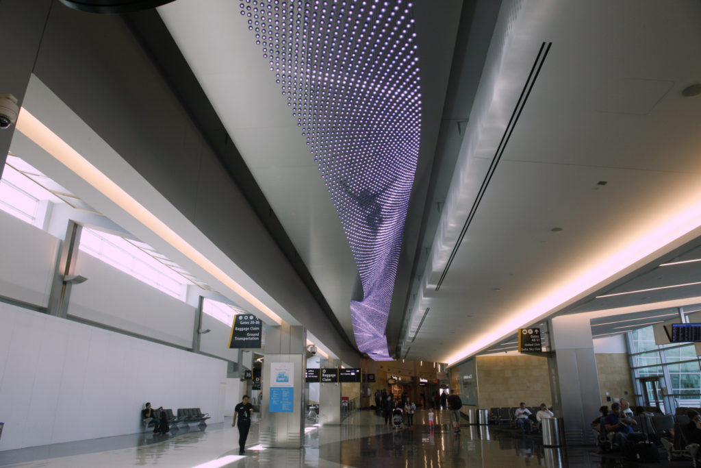 Journey, 2013, Custom electronics, 38,000 LEDs, 8 x 10 x 700 feet, Installation View, San Diego International Airport, Photography credit: Courtesy of the artist