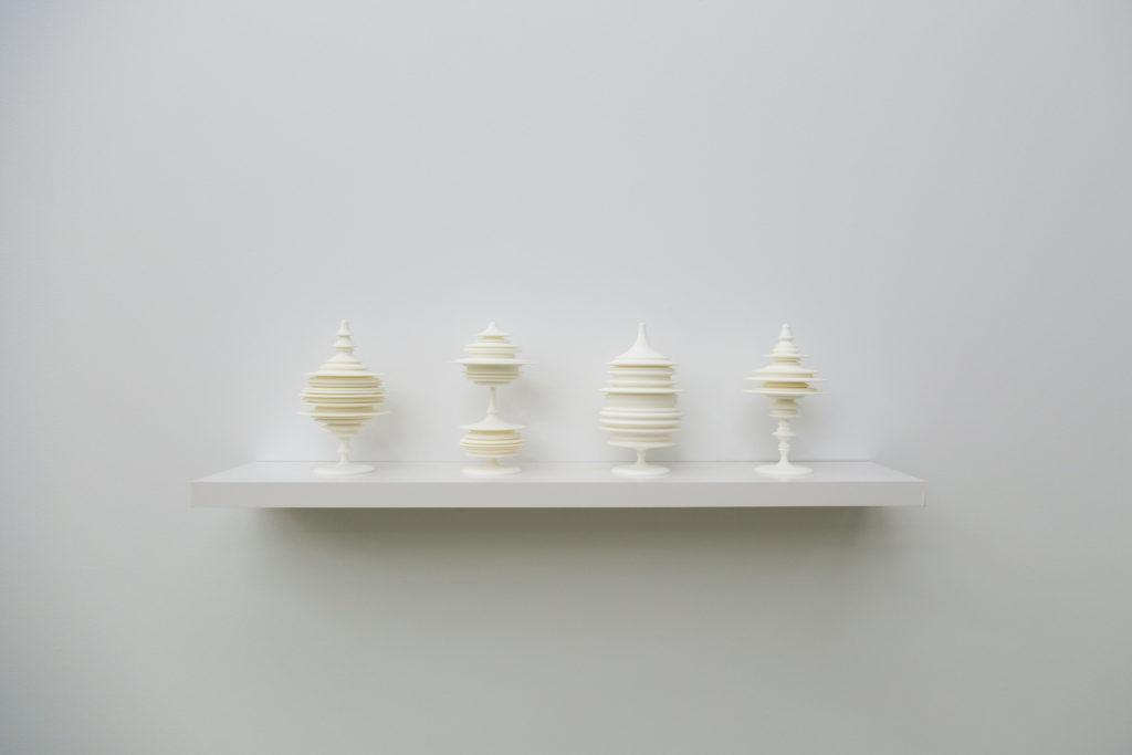 """Manifest (installation view), 2015, laser sintered polyamide nylon, 8""""H x 4.75""""W x 4.75""""D each"""